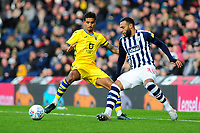 Kyle Naughton of Swansea City battles with Matt Phillips of West Bromwich Albion during the Sky Bet Championship match between West Bromwich Albion and Swansea City at The Hawthorns in Birmingham, England, UK. Sunday 08 December 2019