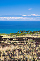 A lava field and Kiholo Bay along the Kohala Coast of the Big Island, with Maui's Haleakala in the distance.