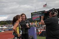 Laura Roesler waits to be interviewed by ESPNU reporter Jill Montgomery after Roesler's victory in the 800-meters at the 2014 NCAA Division I Outdoor Track and Field Championships in Eugene, Or. Friday, June 13.
