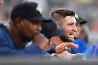 Designated hitter Tim Tebow (15) of the Columbia Fireflies watches with coaches Jonathan Hurst and Joel Fuentes during a game against the Lexington Legends on Thursday, June 8, 2017, at Spirit Communications Park in Columbia, South Carolina. Columbia won, 8-0. (Tom Priddy/Four Seam Images)