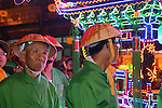 Donggang, Taiwan --- Worshipers in the procession following the King Boat through the village streets to the burning site near the sea.