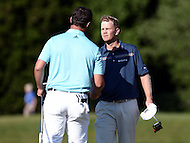 Bethesda, MD - June 25, 2016: Billy Hurley III greets Jon Rahm on the 18th hole at the end of Round 3 of the Quicken Loans National Tournament at the Congressional Country Club in Bethesda, MD, June 25, 2016.  (Photo by Don Baxter/Media Images International)