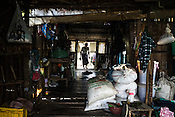 A fishermen walks into his house in Kant Ma Lar Chang Village in Pyapon district of Myanmar.