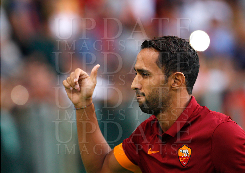 Calcio, amichevole Roma vs Fenerbahce. Roma, stadio Olimpico, 19 agosto 2014.<br /> AS Roma defender Mehdi Benatia, of Morocco, greets fans during the team's presentation, prior to the friendly match between AS Roma and Fenerbache at Rome's Olympic stadium, 19 August 2014.<br /> UPDATE IMAGES PRESS/Riccardo De Luca