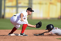 Surprise Saguaros infielder Sean Coyle (2) waits for a throw as Kelby Tomlinson (18) slides in during an Arizona Fall League game against the Scottsdale Scorpions on October 16, 2014 at Surprise Stadium in Surprise, Arizona.  Surprise defeated Scottsdale 7-3.  (Mike Janes/Four Seam Images)