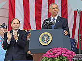 United States President Barack Obama makes remarks in the Memorial Amphitheater at Arlington National Cemetery in Arlington, Virginia after laying a wreath at the Tomb of the Unknown Soldier on Veteran's Day, Friday, November 11, 2016.  US Secretary of Veterans Affairs Robert A. McDonald looks on from left.<br /> Credit: Ron Sachs / Pool via CNP