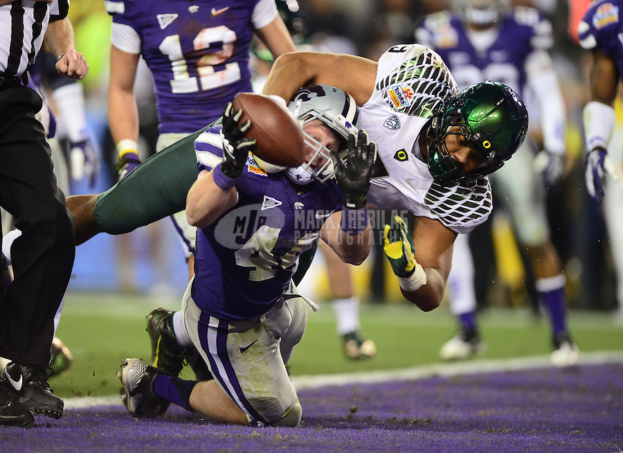 Jan. 3, 2013; Glendale, AZ, USA: Oregon Ducks defensive lineman Arik Armstead (9) tackles Kansas State Wildcats defensive end Ryan Mueller (44) in the end zone on a blocked extra point in the third quarter during the 2013 Fiesta Bowl at University of Phoenix Stadium. Oregon defeated Kansas State 35-17. Oregon would be rewarded with a 1 point safety. Mandatory Credit: Mark J. Rebilas-