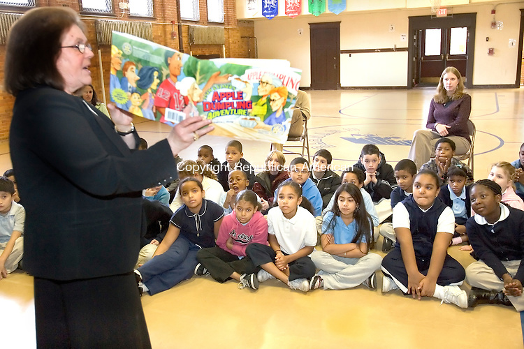 WATERBURY, CT-- 15 NOVEMBER 2007--111607JS01- Patricia Moran, Co-Chair of the Waterbury Rotary Dictionary Project, left, reads the book 'Andy and Elmer's Apple Dumpling Adventure' to third grade students at Barnard School in Waterbury on Friday as part of International Literacy Day. The Waterbury Rotary Club, distributed dictionaries to more than 1600 third grade students in the city of Waterbury. The donations are made possible with support from the Rotary Clib of Waterbury, the Republican-American, Savings Bank of Danbury and Cipriano Training &amp; Development, Inc. <br /> Jim Shannon / Republican-American