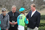 HOT SPRINGS, AR - FEBRUARY 19: Jockey Corey Lanerie being congratulated by trainer Wesley Hawley in the winners circle after winning the Razorback Handicap at Oaklawn Park on February 19, 2018 in Hot Springs, Arkansas. (Photo by Justin Manning/Eclipse Sportswire/Getty Images)