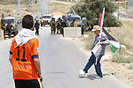 Palestinian activists play football in front of Israeli security forces during a demonstration against the Israeli Football Federation, in the West Bank village of Nabi Saleh, near Ramallah, 29 May 2015. The Palestinian Football Federation is launching a campaign for the suspension of Israel's membership in FIFA, ahead of voting during the FIFA Congress in Lausanne, Switzerland. PFA wants FIFA to suspend the Israeli Football Association (IFA) unless Israel lifts its restrictions on the movement of Palestinian athletes between the Gaza Strip and the West Bank and on imports of sports equipment bound for the Palestinian territories. Photo by Shadi Hatem