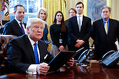 US President Donald Trump (F), with White House chief of staff Reince Pribus (L), counselor to the President Kellyanne Conway (2L), White House Communications Director Hope Hicks (3L), Senior Advisor Jared Kushner (2R) and Senior Counselor Stephen Bannon (R), delivers remarks after signing one of five executive orders related to the oil pipeline industry in the oval office of the White House in Washington, DC, USA, 24 January 2017. President Trump has a full day of meetings including one with Senate Majority Leader Mitch McConnell and another with the full Senate leadership.<br /> Credit: Shawn Thew / Pool via CNP
