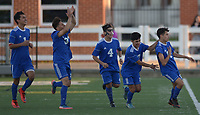 NWA Democrat-Gazette/ANDY SHUPE<br /> Rogers junior Brayan Flores (right) celebrates Tuesday, April 10, 2018, with teammates after scoring the game-winning goal during the second half against Springdale at Jarrell Williams Bulldog Stadium in Springdale. Visit nwadg.com/photos to see more photographs from the match.