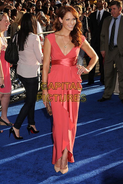 "Amanda Righetti.Premiere of ""Captain America: The First Avenger"" held at The El Capitan Theatre in Hollywood, California, USA..July 19th, 2011.full length pink silk satin dress wrap sash hand on hip.CAP/ADM/BP.©Byron Purvis/AdMedia/Capital Pictures."