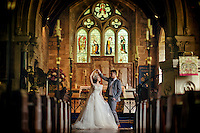 A Chinese couple pose for their wedding photos in St Mary's Church, Lower Slaughter, The Cotswolds, UK.  Chinese couples often use the church for wedding photos. An increasing number of Chinese couple are having their wedding photos taken in the English country-side, classic towns and monuments to show in China.