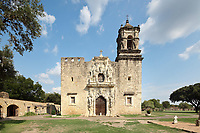 West facade of the church with bell tower and ornate portal, built 1768, at the Mission San Jose, or Mission San Jose y San Miguel de Aguayo, a Spanish catholic colonial mission and church originally established in 1720 and completed in 1782, to spread Christianity among Native Americans, the largest of 4 missions in the San Antonio Missions National Historical Park, in San Antonio, Texas, USA. This facade was restored 1947-52 by Archbishop Robert E Lucey. The complex was home to 350 Indians and had its own mill and granary. It was restored in the 1930s and again in 2011. It forms part of the San Antonio Missions UNESCO World Heritage Site. Picture by Manuel Cohen