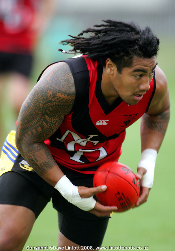 Ma'a Nonu tries Porirua's North City Demons AFL top on for size during the Preseason Cross-code Rugby Union v Australian Rules friendly between the Hurricanes and Wellington Tigers at  Elsdon Park, Porirua, New Zealand on Tuesday, 15 January 2008. Photo: Dave Lintott / lintottphoto.co.nz