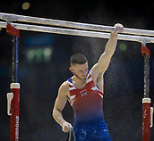 21st March 2018, Arena Birmingham, Birmingham, England; Gymnastics World Cup, day one, mens competition; Dominick Cunningham (GBR) putting chalk on the Parallel Bars during the warm up before the competition begins