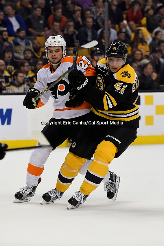 Wednesday, October 21, 2015: Philadelphia Flyers center Scott Laughton (21) and Boston Bruins left wing Joonas Kemppainen (41) jostle for position during the National Hockey League game between the Philadelphia Flyers and the Boston Bruins, held at TD Garden, in Boston, Massachusetts. The Flyers defeat the Bruins 5-4 in overtime. Eric Canha/CSM