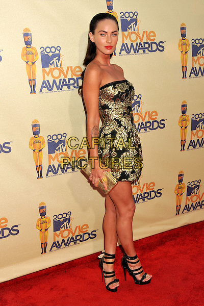 MEGAN FOX.18th Annual MTV Movie Awards - Arrivals held at the Universal Gibson Amphitheater, Universal City, CA, USA..May 31st, 2009.full length black gold floral print strapless dress clutch bag sandals platform tattoo.CAP/ADM/BP.©Byron Purvis/AdMedia/Capital Pictures.
