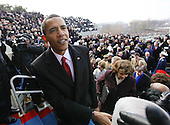 Washington, DC - January 20, 2009 -- United States President Barack Obama greets guests after he is sworn-in as the 44th President of the United States and the first African-American to lead the nation, at the Capitol in Washington, Tuesday, January 20, 2009..Credit: J. Scott Applewhite - Pool via CNP