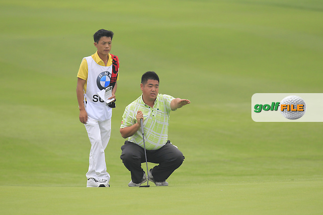 Su Dong (CHN) on the 9th green during Saturay's Round 3 of the 2014 BMW Masters held at Lake Malaren, Shanghai, China. 1st November 2014.<br /> Picture: Eoin Clarke www.golffile.ie