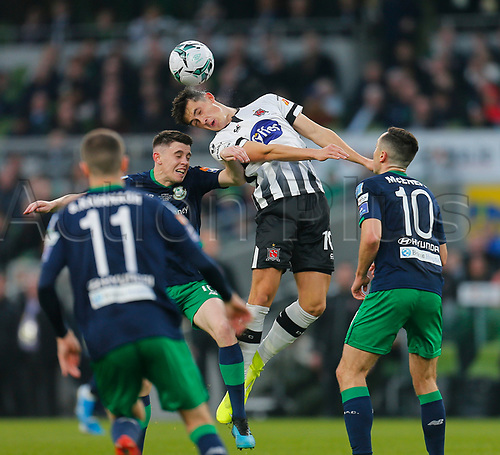 3rd November 2019; Aviva Stadium, Dublin, Leinster, Ireland; FAI Cup Final Football, Dundalk Football Club versus Shamrock Rovers; Jamie McGrath of Dundalk FC stretches to win the header in front of the Shamrock Rovers goal - Editorial Use