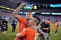 East Rutherford, NJ - Sunday June 26, 2016: Chile celebrates, Arturo Vidal, Gary Medel during a Copa America Centenario finals match between Argentina (ARG) and Chile (CHI) at MetLife Stadium.