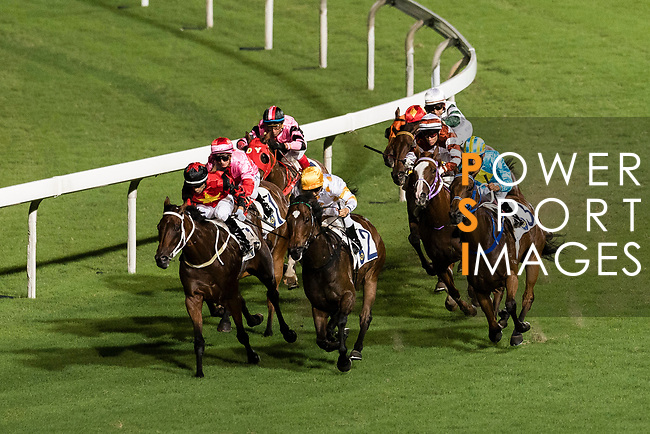 Jockey Joao Moreira riding Regency Honey (L) leading the race 2 during Hong Kong Racing at Happy Valley Racecourse on September 13, 2017 in Hong Kong, China. Photo by Marcio Rodrigo Machado / Power Sport Images