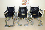 Three unoccupied wheel chairs. Royalty Free