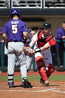 Drew Bianco (5) of the LSU Tigers is tagged out by Georgia Bulldogs catcher Shane Marshall (32) ater striking out on a pitch in the dirt at Foley Field on March 23, 2019 in Athens, Georgia. The Bulldogs defeated the Tigers 2-0. (Brian Westerholt/Four Seam Images)