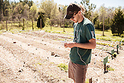 Durham, North Carolina - Wednesday March 30, 2016 - HUB Farm caretaker and Farmer Educator Grant Ruhlman makes plans for the garden while at the farm in Durham.