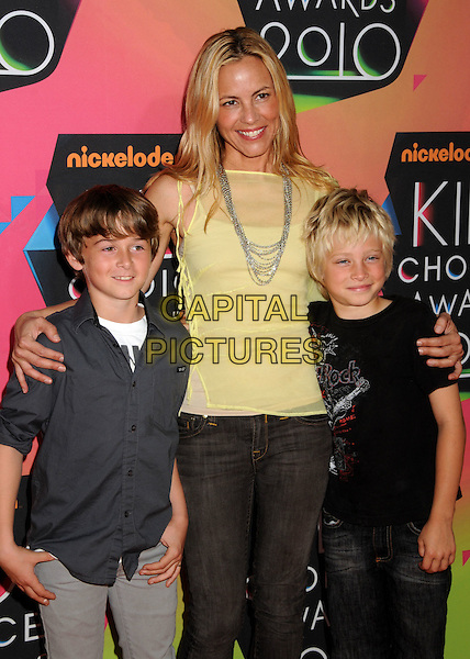 MARIA BELLO (C), JACKSON BLUE McDERMOTT (R) & GUEST.at the 23rd Annual Nickelodeon Kids' Choice Awards 2010 held at Pauley Pavilion in Westwood, California, USA, March 27th 2010 .arrivals kids half length yellow top son mom mum mother family smiling silver necklace .CAP/ADM/BP.©Byron Purvis/Admedia/Capital Pictures
