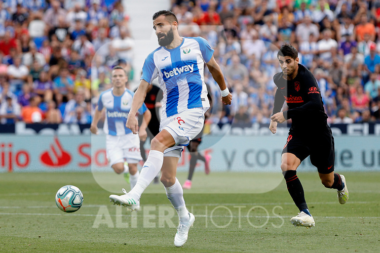 CD Leganes's Dimitrios Siovas and Atletico de Madrid's Alvaro Morata during La Liga match between CD Leganes and Atletico de Madrid at Butarque Stadium in Madrid, Spain. August 25, 2019. (ALTERPHOTOS/A. Perez Meca)