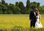 Meg and Jared Jackson stop in a meadow of wild mustard before greeting their well wishers at the nearby reception.