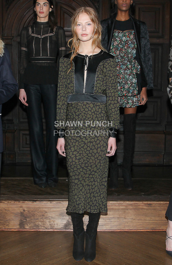 "Model Sophie poses in a loden leopard print Georgette tie neck bias dress, from the Veronica Beard Fall 2016 ""Gypsy Caravan"" collection presentation, at the Highline Hotel on February 15 2016, during New York Fashion Week Fall 2016."