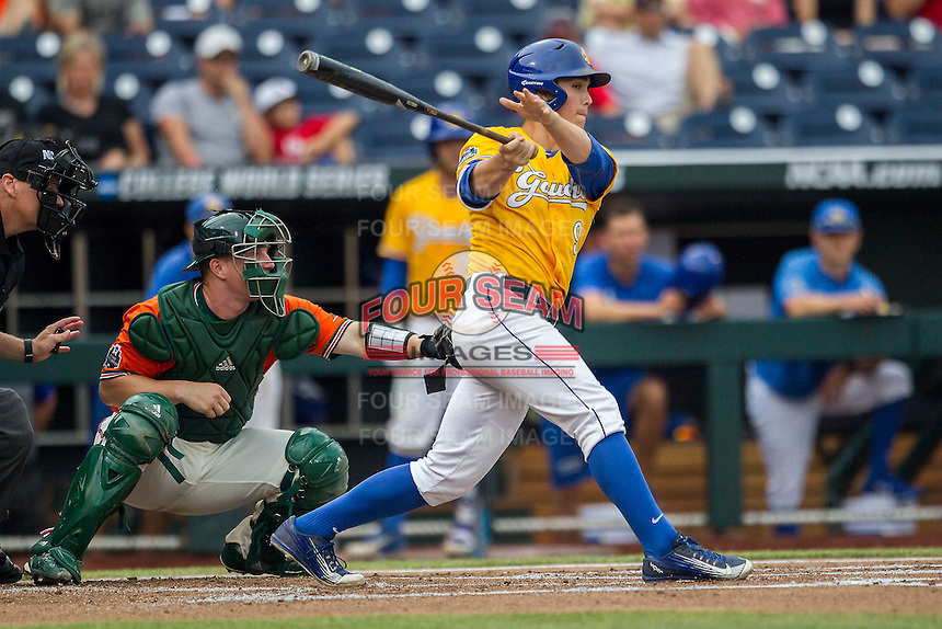 UC Santa Barbara Gauchos second baseman JJ Muno (9) follows through on his swing against the Miami Hurricanes in Game 5 of the NCAA College World Series on June 20, 2016 at TD Ameritrade Park in Omaha, Nebraska. UC Santa Barbara defeated Miami  5-3. (Andrew Woolley/Four Seam Images)