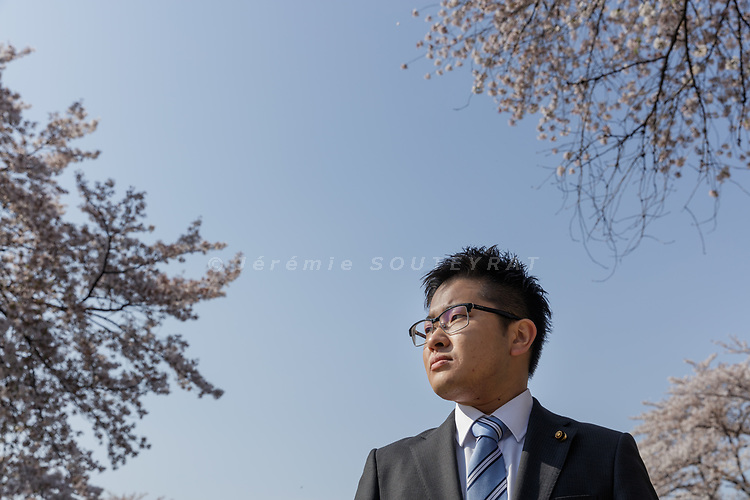 Iruma city, Saitama prefecture, Japan, April 14 2017 - Portrait of Tomoya HOSODA under the cherry blossoms of Iruma city. <br /> Tomoya HOSODA is the first out transgender man to be elected to a public office. He was elected a councillor in the city of Iruma in March 2017. Mr Hosoda officially changed his name and gender in the family registry in 2015 after having come out and transitioned.