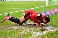 Reece Hall-Johnson of Grimsby Town lands in a muddy puddle during Yeovil Town vs Grimsby Town, Sky Bet EFL League 2 Football at Huish Park on 9th February 2019