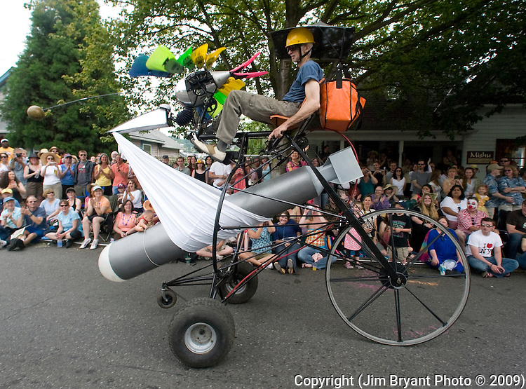A torpedo bomber peddles past the crowd at the 21st Annual Fremont Summer Solstice Parade in Seattle on June 20, 2009. The parade was held Saturday, bringing out painted and naked bicyclists, bands, belly dancers and floats.  (Jim Bryant Photo © 2009)