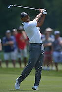 Bethesda, MD - June 27, 2014: Tiger Woods plays his second shot on hole 4 in the 2nd round of play at the Quicken Loans National at the Congressional Country Club in Bethesda, MD, June 27, 2014. The tournament was Woods first since he underwent back surgery earlier in the year. He finished the round at +4. (Photo by Don Baxter/Media Images International)