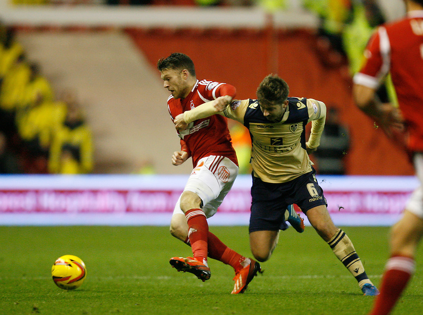 Nottingham Forest's Jamie Mackie (L) and Leeds United's Luke Murphy in action during todays match  <br /> <br /> Photo by Jack Phillips/CameraSport<br /> <br /> Football - The Football League Sky Bet Championship - Nottingham Forest v Leeds United - Sunday 29th December 2013 - The City Ground - Nottingham<br /> <br /> &copy; CameraSport - 43 Linden Ave. Countesthorpe. Leicester. England. LE8 5PG - Tel: +44 (0) 116 277 4147 - admin@camerasport.com - www.camerasport.com