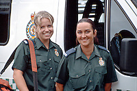 Paramedic crew standing beside their Ambulance. This image may only be used to portray the subject in a positive manner..©shoutpictures.com..john@shoutpictures.com