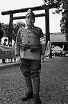 A Japanese nationalist dressed in WWII uniform poses for a photo at Yasukuni Shrine in Tokyo, Japan. very year on August 15, the day Japan officially surrendered in WWII, tens of thousands of Japanese visit the controversial shrine to pay their respects to the 2.46 million war dead enshrined there, the majority of which are soldiers and others killed in WWII and including 14 Class A convicted war criminals, such as Japan's war-time prime minister Hideki Tojo. Each year speculation escalates as to whether the country's political leaders will visit the shrine, the last to do so being Junichiro Koizumi in 2005. Nationalism in Japan is reportedly on the rise, while sentiment against the nation by countries that suffered from Japan's wartime brutality, such as China, has been further aggravated by Japan's insistence on glossing over its wartime atrocities in school text books...Photographer:Robert Gilhooly..