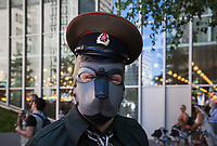 Man wearing leather dog mask and Russian hat, Seattle Pride Parade 2016, Washington, USA.