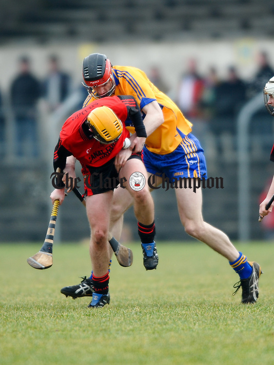 Down's Connor Woods is tackled by Clare's Darach Honan during their Division 2 National League game at Cusack park. Photograph