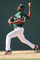 Starting pitcher Myles Smith (21) of the Greenville Drive delivers a pitch in a game against the Savannah Sand Gnats on Sunday, June 22, 2014, at Fluor Field at the West End in Greenville, South Carolina. Greenville won, 7-3. (Tom Priddy/Four Seam Images)