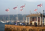 RNLI flags flying in the breeze on Prince of Wales pier, Falmouth, Cornwall, England, UK