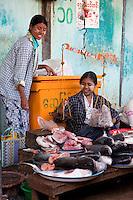 Myanmar, Burma.  Weighing Fish in the Bagan Market.