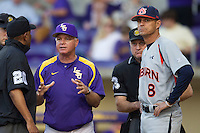 LSU Tigers coach Paul Mainieri talks with the umpires and Auburn Tigers coach John Pawlowski #8 before the NCAA baseball game on March 22nd, 2013 at Alex Box Stadium in Baton Rouge, Louisiana. LSU defeated Auburn 9-4. (Andrew Woolley/Four Seam Images).