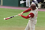 Washington State senior, Michael Weber (#10), connects with a pitch off of the end of the bat during the Cougars Pac-10 conference tilt with arch-rival Washington in Seattle, Washington, on April 3, 2010.